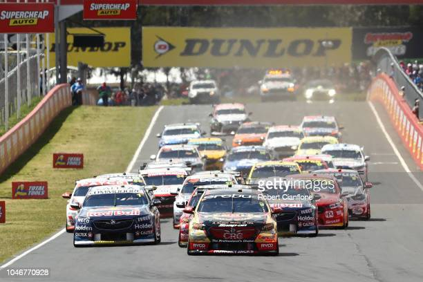 David Reynolds driver of the Erebus Penrite Racing Holden Commodore ZB leads the field into the first corner during the Bathurst 1000 which is race...