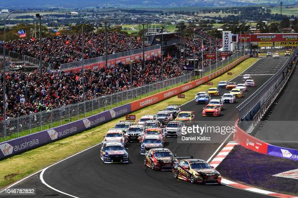 David Reynolds drives the Erebus Penrite Racing Holden Commodore ZB leads at the start of the Bathurst 1000 which is race 25 of the Supercars...
