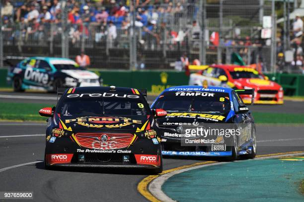 David Reynolds drives the Erebus Penrite Racing Holden Commodore ZB leads Nick Percat drives the Brad Jones Racing Commodore ZB during race 4 for the...