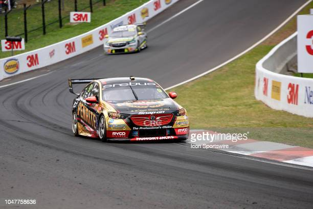 David Reynolds / Luke Youlden in the Erebus Penrite Racing Holden Commodore being chased down by Race Winners Craig Lowndes / Steven Richards in the...
