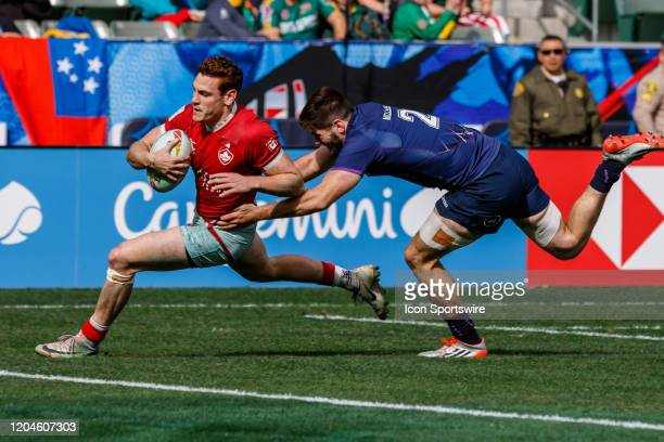 David Richard of Canada scores despite tackle from Ross McCann of Scotland in Match Canada vs Scotland during the LA Sevens Round 5 of the HSBC World...