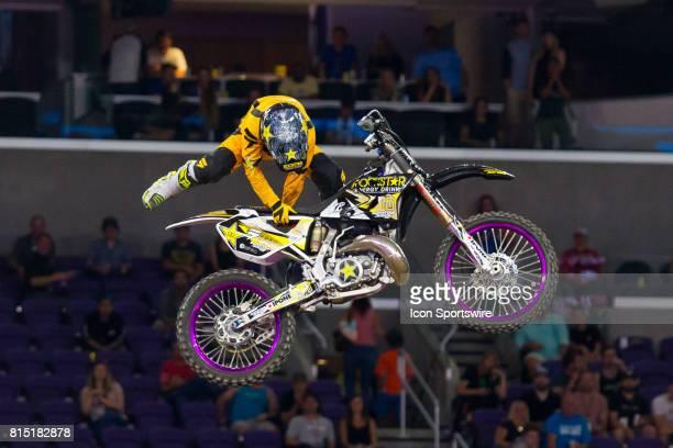 David Rinaldo grabs his dirtbike during Moto X Freestyle at X Games Minneapolis on July 14 2017 at US Bank Stadium in Minneapolis Minnesota