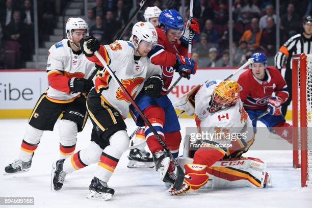 David Rittich and Sam Bennett of the Calgary Flames defend the net against Charles Hudon of the Montreal Canadiens in the NHL game at the Bell Centre...