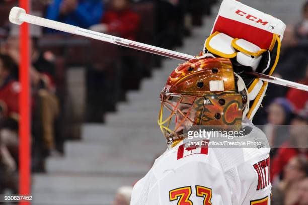 David Rittich of the Calgary Flames adjusts his mask during a game against the Ottawa Senators at Canadian Tire Centre on March 9 2018 in Ottawa...