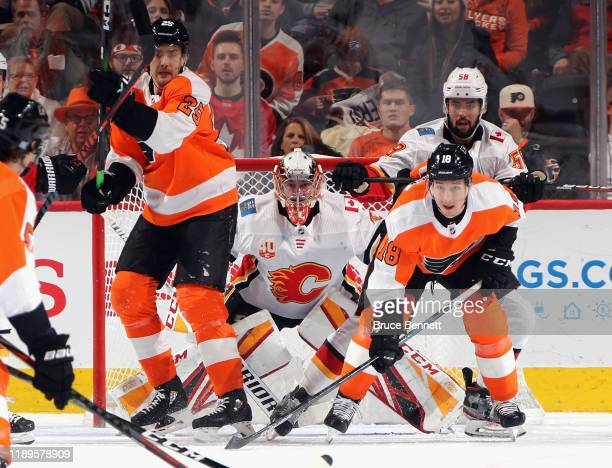 David Rittich of the Calgary Flames awaits a shot from the point during the first period against the Philadelphia Flyers at the Wells Fargo Center on...