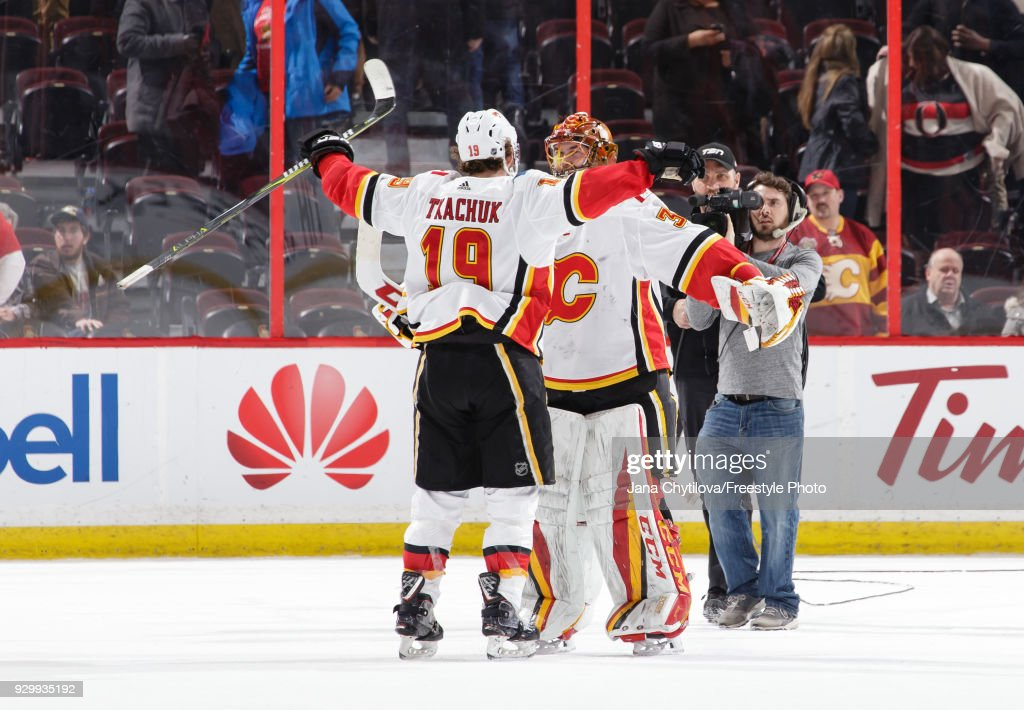 David Rittich #33 of the Calgary Flames celebrate their win against the Ottawa Senators with teammate Matthew Tkachuk #19 at Canadian Tire Centre on March 9, 2018 in Ottawa, Ontario, Canada.