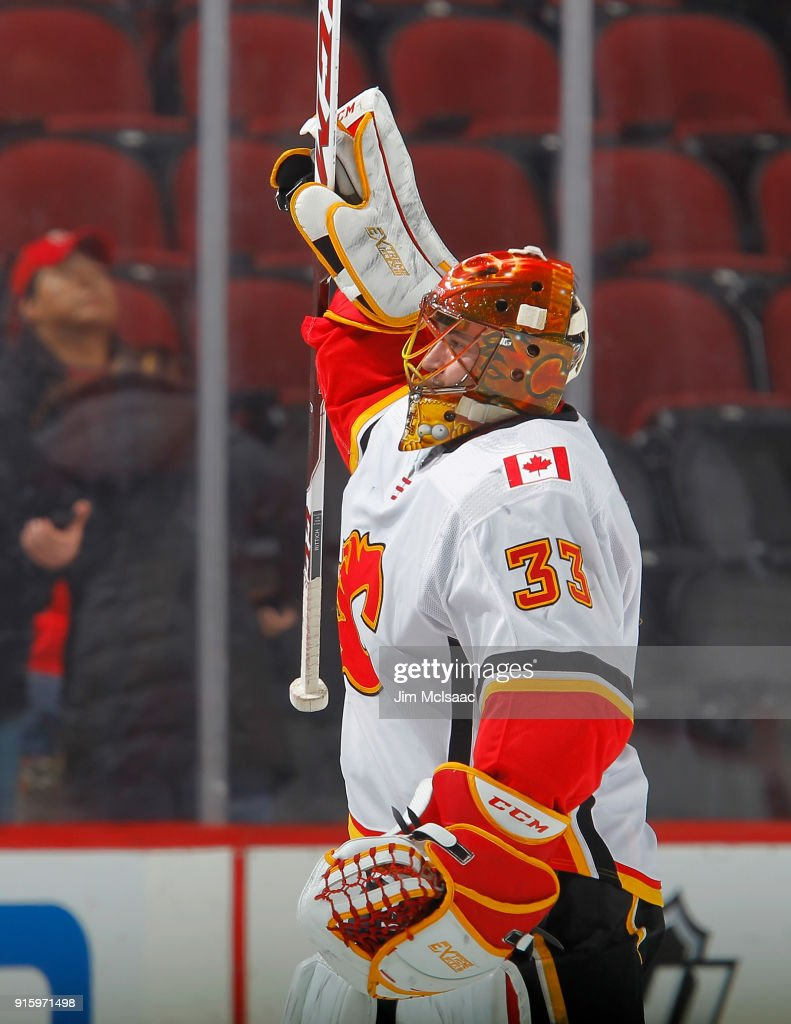 David Rittich #33 of the Calgary Flames celebrates after defeating the New Jersey Devils on February 8, 2018 at Prudential Center in Newark, New Jersey.
