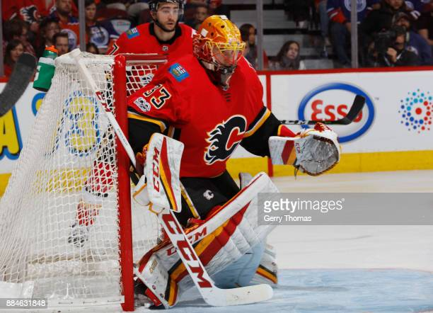 David Rittich of the Calgary Flames comes in relief of Mike Smith against the Edmonton Oilers at Scotiabank Saddledome on December 2 2017 in Calgary...