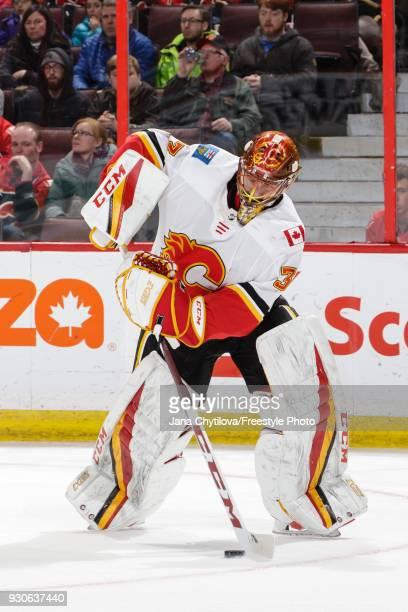 David Rittich of the Calgary Flames corals the puck in a game against the Ottawa Senators at Canadian Tire Centre on March 9 2018 in Ottawa Ontario...