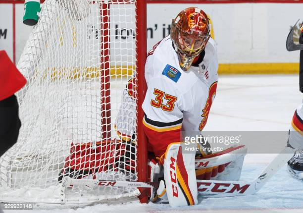 David Rittich of the Calgary Flames guards his net against the Ottawa Senators at Canadian Tire Centre on March 9 2018 in Ottawa Ontario Canada