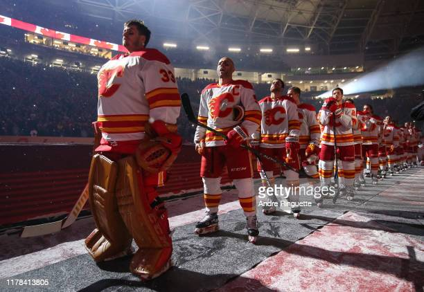 David Rittich of the Calgary Flames listens to the Canadian national anthem before taking on the Winnipeg Jets during the 2019 Tim Hortons NHL...