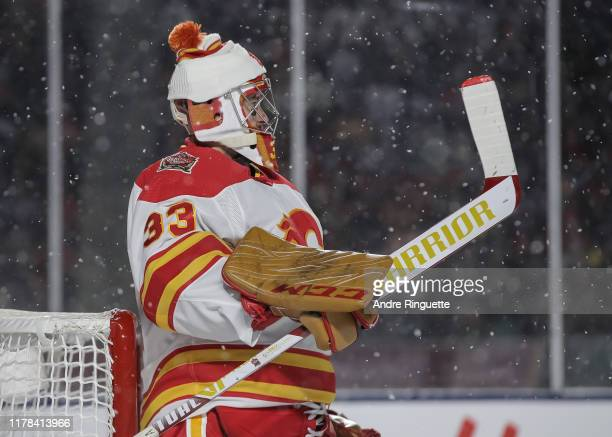 David Rittich of the Calgary Flames looks on during a stoppage in play against the Winnipeg Jets during the 2019 Tim Hortons NHL Heritage Classic at...