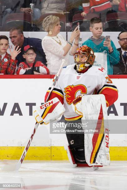 David Rittich of the Calgary Flames looks on during warmups prior to a game against the Ottawa Senators at Canadian Tire Centre on March 9 2018 in...