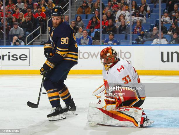David Rittich of the Calgary Flames makes a save against Ryan O'Reilly of the Buffalo Sabres during an NHL game on March 7 2018 at KeyBank Center in...