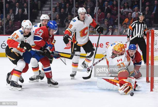 David Rittich of the Calgary Flames makes a save against the Montreal Canadiens in the NHL game at the Bell Centre on December 7 2017 in Montreal...