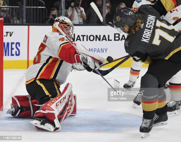 David Rittich of the Calgary Flames makes a save against William Karlsson of the Vegas Golden Knights in the second period of their game at T-Mobile...