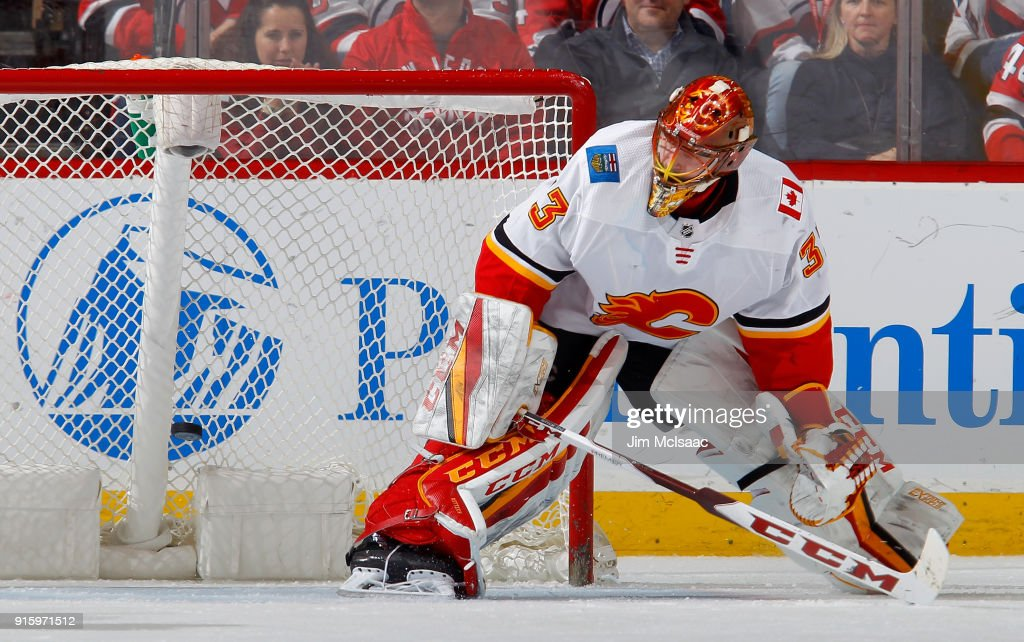 David Rittich #33 of the Calgary Flames makes a save in the third period against the New Jersey Devils on February 8, 2018 at Prudential Center in Newark, New Jersey.