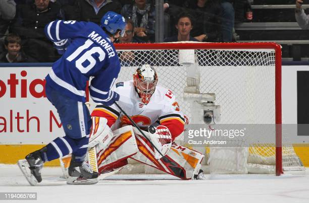 David Rittich of the Calgary Flames makes the game winning stop against Mitchell Marner of the Toronto Maple Leafs during an NHL game at Scotiabank...