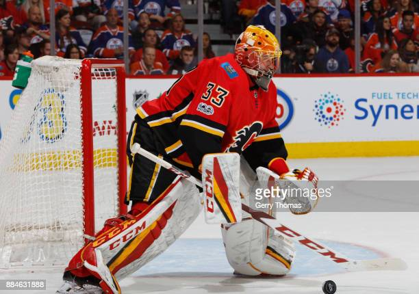 David Rittich of the Calgary Flames plays the puck against the Edmonton Oilers at Scotiabank Saddledome on December 2 2017 in Calgary Alberta Canada