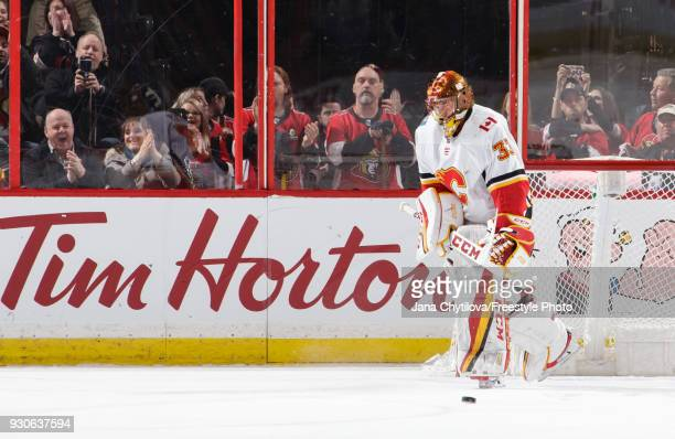 David Rittich of the Calgary Flames reacts after allowing a goal on a penalty shot and thus ruining his shutout bid against the Ottawa Senators at...