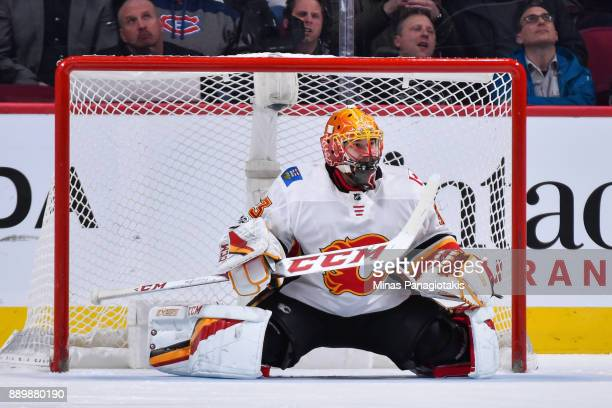 David Rittich of the Calgary Flames stays low in front of his net against the Montreal Canadiens during the NHL game at the Bell Centre on December 7...