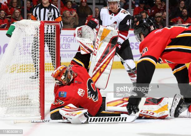 David Rittich of the Calgary Flames stretches to cover his net in an NHL game against the Arizona Coyotes on November 5 2019 at the Scotiabank...