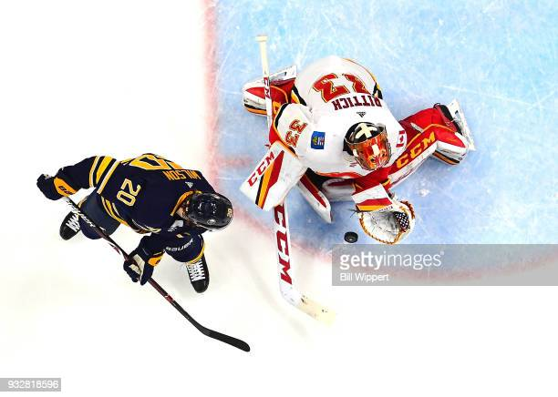 David Rittich of the Calgary Flames tends goal during an NHL game against Scott Wilson of the the Buffalo Sabres on March 7 2018 at KeyBank Center in...