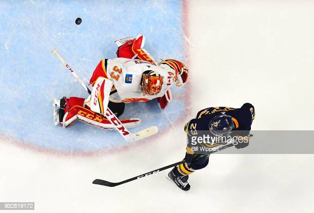 David Rittich of the Calgary Flames tends goal during an NHL game against Sam Reinhart of the the Buffalo Sabres on March 7 2018 at KeyBank Center in...
