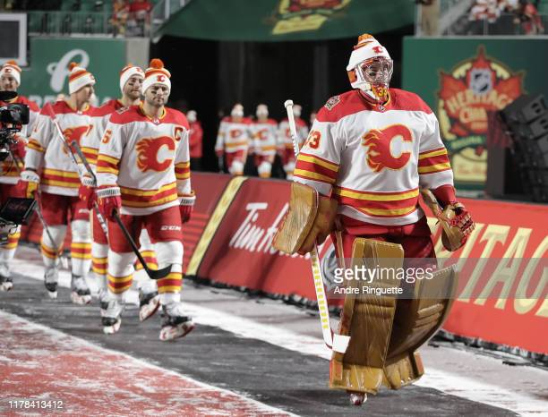 David Rittich of the Calgary Flames walks to the ice for warmup before taking on the Winnipeg Jets during the 2019 Tim Hortons NHL Heritage Classic...