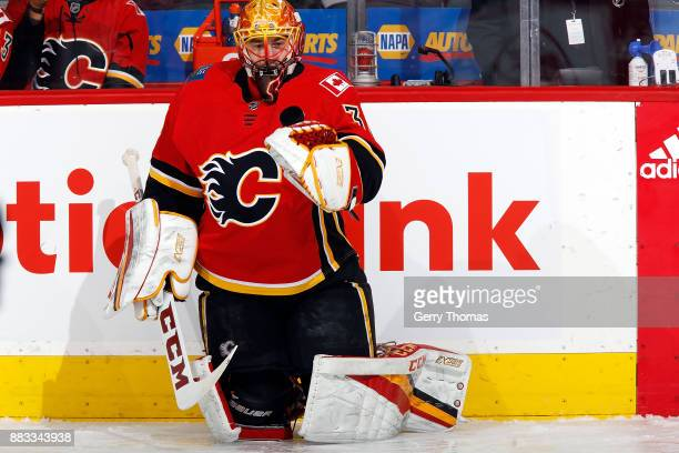 David Rittich of the Calgary Flames warms up before an NHL game against the Arizona Coyotes on November 30 2017 at the Scotiabank Saddledome in...