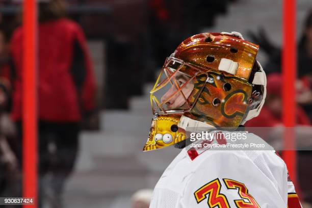 David Rittich of the Calgary Flames watches the jumbotron during a stoppage in play in a game against the Ottawa Senators at Canadian Tire Centre on...