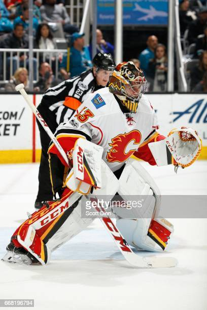 David Rittich of the Calgary Flames watches the puck during a NHL game against the San Jose Sharks at SAP Center at San Jose on April 8 2017 in San...