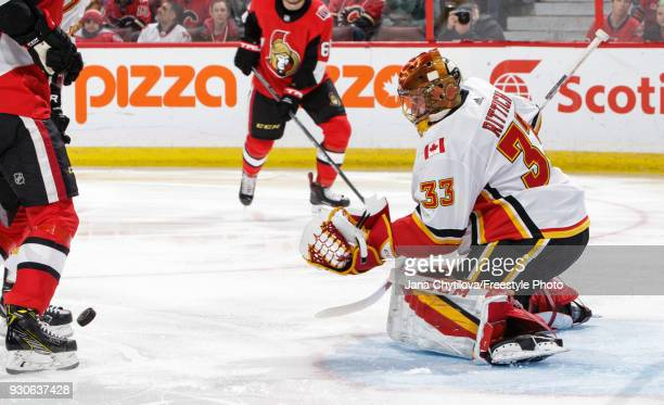 David Rittich of the Ottawa Senators tracks the rebound after making a save against the Ottawa Senators the Calgary Flames at Canadian Tire Centre on...