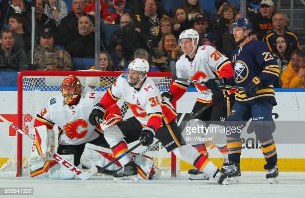 David Rittich Troy Brouwer and Michael Stone of the Calgary Flames defend against Sam Reinhart of the Buffalo Sabres during an NHL game on March 7...