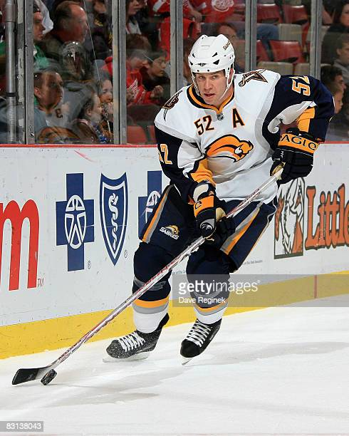 David Rivet of the Buffalo Sabres skates out from behind the net with the puck during a NHL preseason game against the Detroit Red Wings on October 5...
