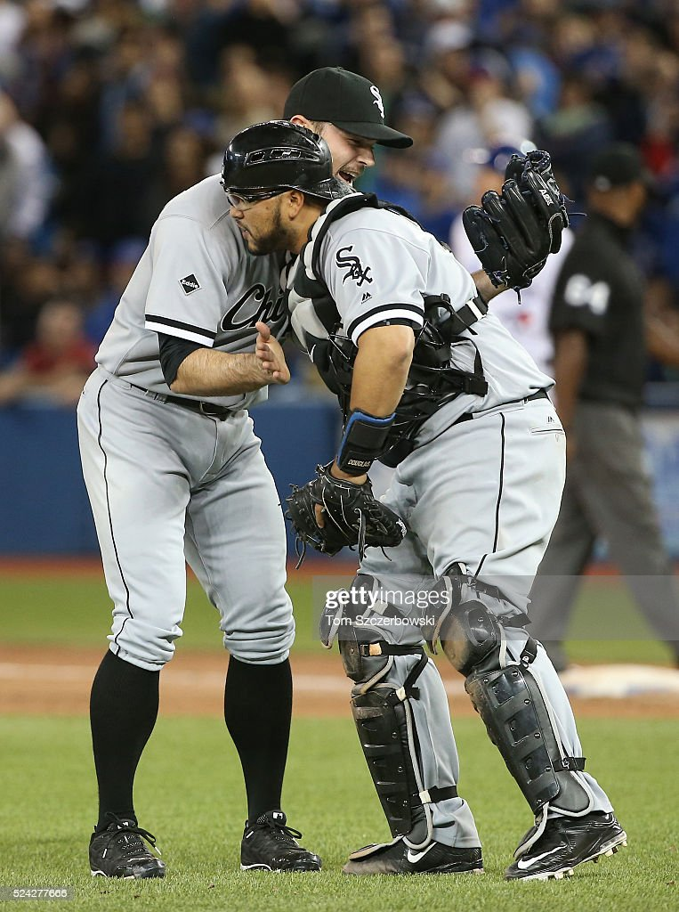 David Robertson #30 of the Chicago White Sox celebrates their victory with Dioner Navarro #27 during MLB game action against the Toronto Blue Jays on April 25, 2016 at Rogers Centre in Toronto, Ontario, Canada.