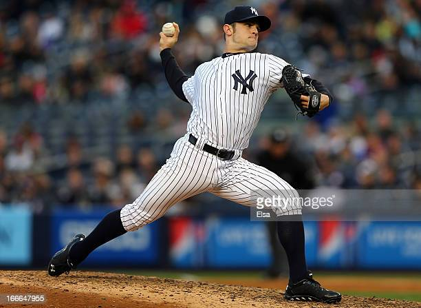 David Robertson of the New York Yankees delivers a pitch against the Baltimore Orioles on April 13 2013 at Yankee Stadium in the Bronx borough of New...