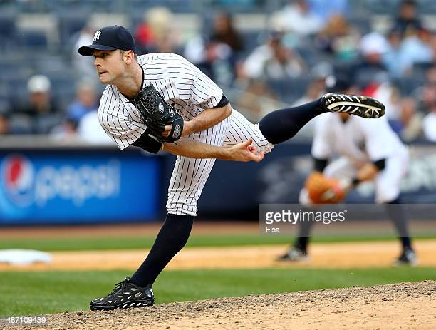 David Robertson of the New York Yankees delivers a pitch against the Los Angeles Angels of Anaheim on April 26 2014 at Yankee Stadium in the Bronx...