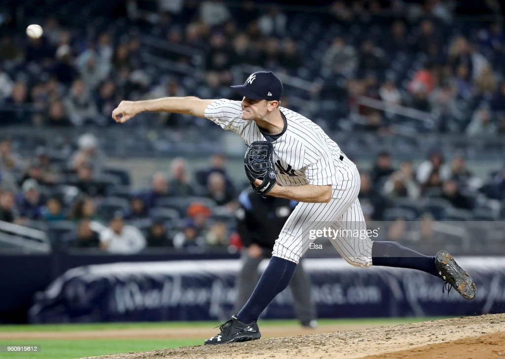 David Robertson #30 of the New York Yankees delivers a pitch against the Minnesota Twins at Yankee Stadium on April 24, 2018 in the Bronx borough of New York City.