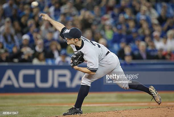 David Robertson of the New York Yankees delivers a pitch in the ninth inning during MLB game action against the Toronto Blue Jays on April 6 2014 at...