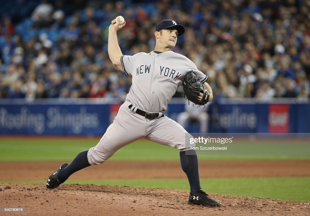 David Robertson #30 of the New York Yankees delivers a pitch in the eighth inning during MLB game action against the Toronto Blue Jays at Rogers Centre on April 1, 2018 in Toronto, Canada.