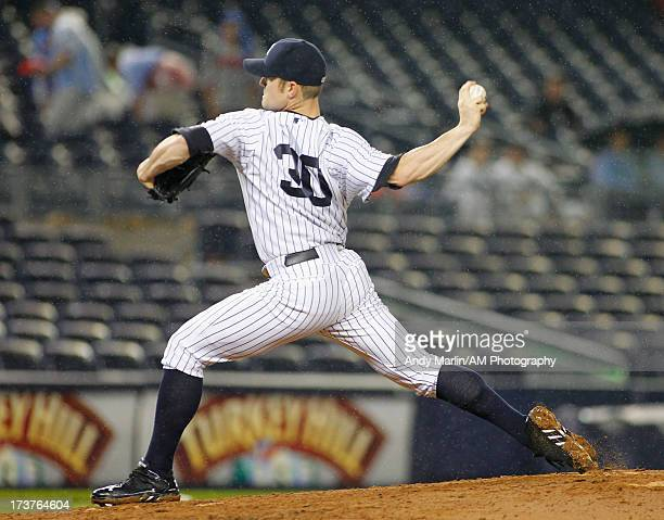 David Robertson of the New York Yankees pitches against the Minnesota Twins at Yankee Stadium on July 12 2013 in the Bronx borough of New York City