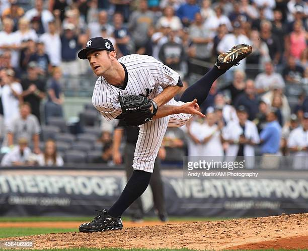 David Robertson of the New York Yankees pitches against the Toronto Blue Jays during the game at Yankee Stadium on September 21 2014 in the Bronx...