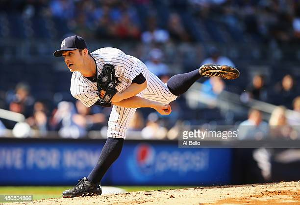 David Robertson of the New York Yankees pitches in the ninth inning against the Minnesota Twins during their game at Yankee Stadium on May 31 2014 in...