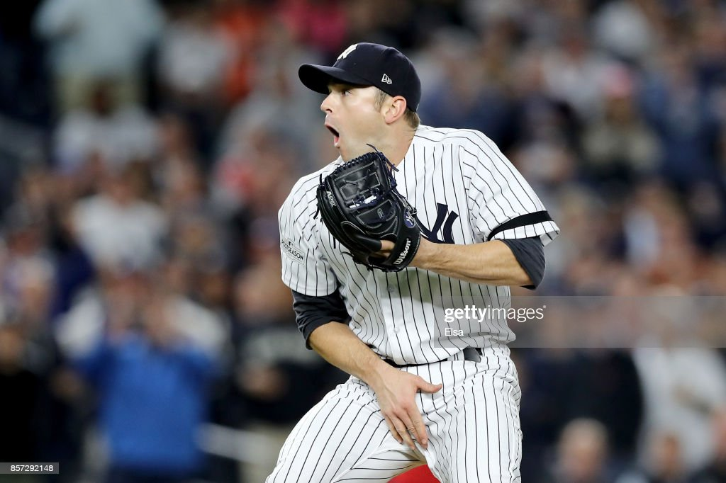David Robertson #30 of the New York Yankees reacts after hitting catcher Gary Sanchez #24 with a wild pitch against the Minnesota Twins during the sixth inning in the American League Wild Card Game at Yankee Stadium on October 3, 2017 in the Bronx borough of New York City.