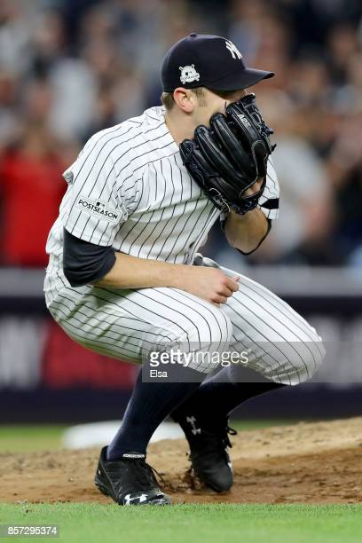 David Robertson of the New York Yankees reacts after hitting catcher Gary Sanchez with a wild pitch against the Minnesota Twins during the sixth...