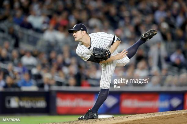 David Robertson of the New York Yankees throws a pitch against the Minnesota Twins in the third inning in the American League Wild Card Game at...