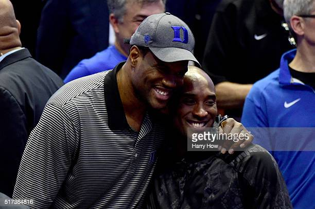 David Robinson and Kobe Bryant pose for a picture at halftime in the 2016 NCAA Men's Basketball Tournament West Regional at the Honda Center on March...