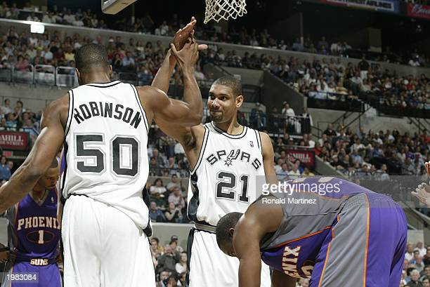 David Robinson and Tim Duncan of the San Antonio Spurs give each other a highfive in Game five of the Western Conference Quarterfinals against the...