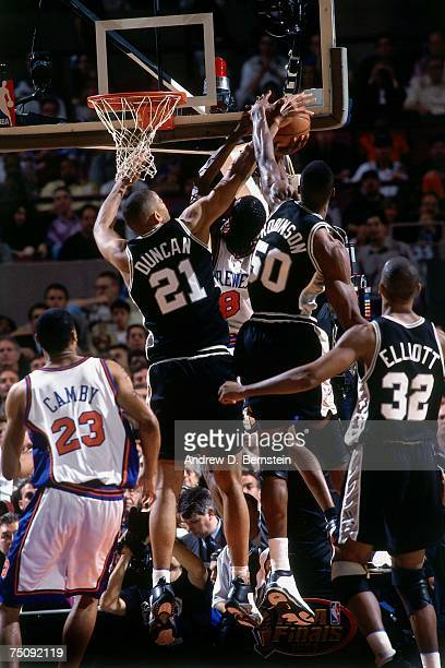 David Robinson and Tim Duncan of the San Antonio Spurs reject a shot attempt by Latrell Sprewell of the New York Knicks in Game Five of the 1999 NBA...